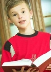 young boy holding Bible